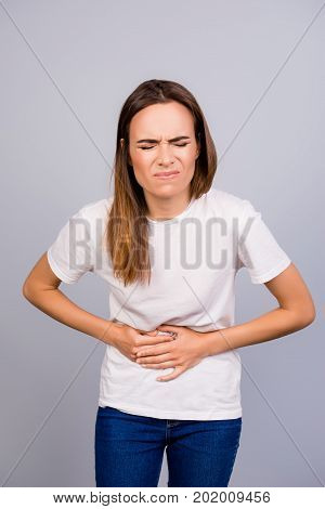 Sad Young Brown Haired Woman In Casual Outfit Is Suffering From Stomach Pain, Ache Is Very Hard, Str