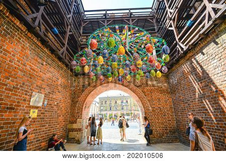 Lublin, Poland - August 10, 2017: Beautiful street decoration under Cracow gate for Mountebanks Carnaval in Lublin, Poland. Lublin old town city center, Poland.
