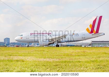 Stuttgart Germany - April 29 2017: Airbus airplane A319-100 from Germanwings / Lufthansa Group on runway airport Stuttgart - meadow in front