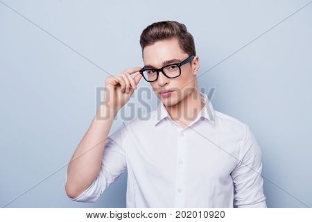 Close Up Portrait Of Confident Young Charming Smart Man With Stylish Hairdo In White Shirt Touching