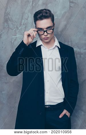 Vertical Photo Of Handsome Smart Young Stylish Jentleman In Trendy Clothes Holding Hand In Pocket An