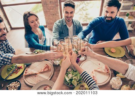 Cheers! High Angle View Of Friends At Birthday Party Clinking Glasses With Champagne And Toasting, T