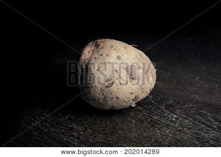 Wild Yam On Wooden Table With Dark Light Background