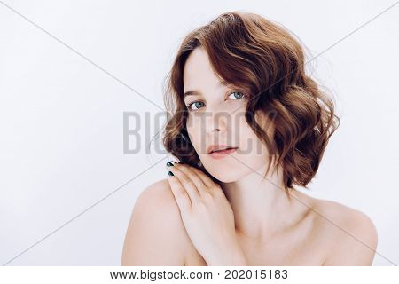 Beauty Portrait Of Female With Curly Hair And Natural Skin. Selective Focus. White Background With C