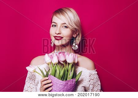 Elegance Beautiful Girl  With  Holiday Make-up Holding A Bouquet Of Tulip
