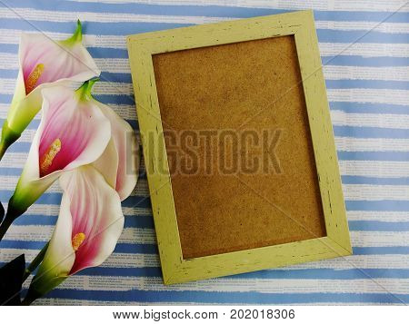 mock up frame home decor with artificial calla lilly flowers bouquet