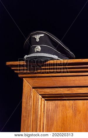 Nazi Cap Exhibited On Wooden Wardrobe