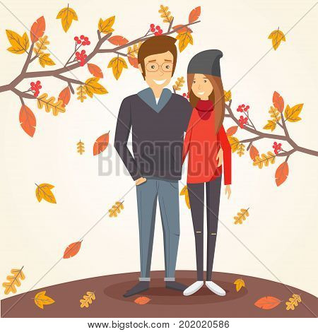 Happy couple in autumn amid falling leaves.