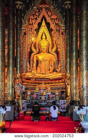 Phisanulok Thailand - April 6 2012 : Buddhists worshiping beautiful Buddha image in Buddhist church in Phitsanulok Thailand