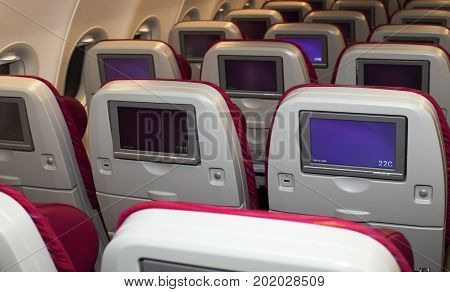 Borispol, Ukraine - August 28, 2017: Qatar Airways Airbus A320 economy class seats with entertainment system onboard. Editorial use only