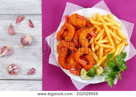Breaded Fried Shrimps, Limes And French Fries