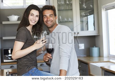 Handsome kitchen couple posing for camera portrait