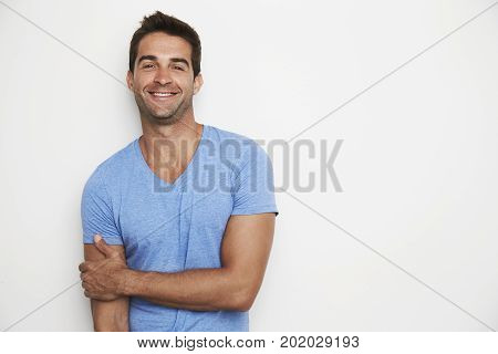 Portrait of Handsome smiling dude in blue