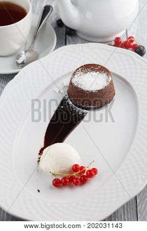 Chocolate flan with ice cream and berries