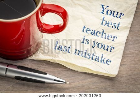 Your best teacher is your last mistake - handwriting on a napkin with a cup of coffee