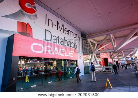 SAN FRANCISCO CA USA - SEPT 22 2013: Attendees of Oracle Open World conference enter Moscone Center South entrance on Sept 22 2013 in San Francisco CA USA.