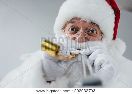 Santa Claus With Party Blowers