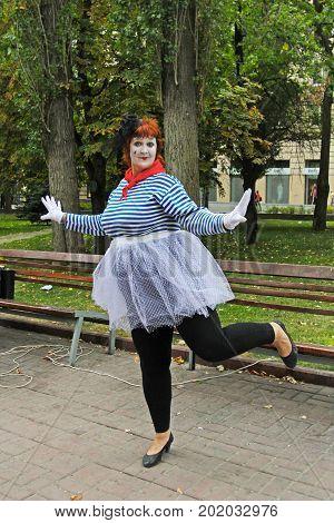 Volgograd Russia - September 01 2013: Plump female street artist at the City Day in Volgograd