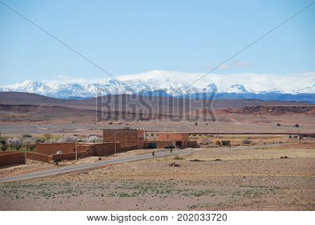 Morocco, passing the Atlas mountains, in the distance.