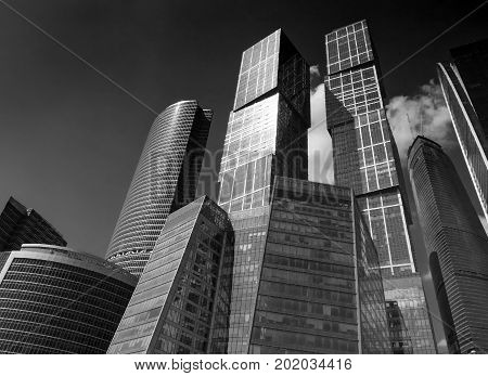 Bottom view on business buildings offices of Moscow-City business center. Black and white Moscow financial business architecture. Famous Moscow sightseeing points tours