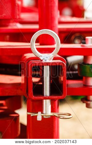 Construction machines concept. Detailed closeup of screw and bolts on red indrustrial machinery