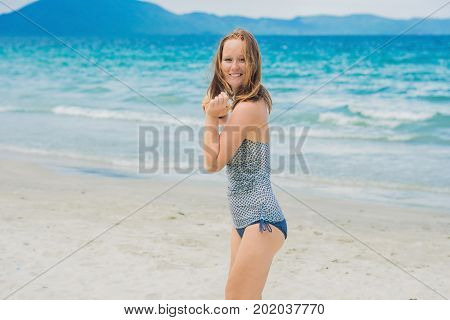 Young Woman Drinking Coconut Milk On Beach.
