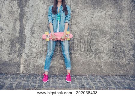Cropped Shot Of Cool Young Hipster Teen In Jeans Outfit And Pink Shoes, Leaning The Concrete Wall, H