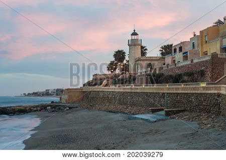 City sunset with the seCity sunset landscape with the sea. Lighthouse at sunseta
