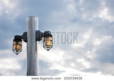 Light in the darkest hour.Streetlamp or lamppost in evening .
