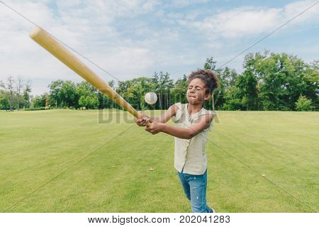 Child Playing Baseball In Park