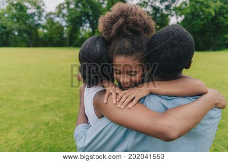 Family Hugging Each Other
