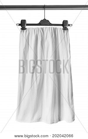 White basic cotton skirt on clothes rack isolated over white