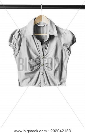 Basic gray blouse on wooden clothes rack isolated over white