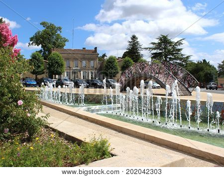 MELLE, FRANCE, JULY 21 2017: View of the town centre fountains on Avenue de Limoges. Melle is a small vibrant town and popular tourist destination in Deux-sevres and home town of Ségolène Royal.