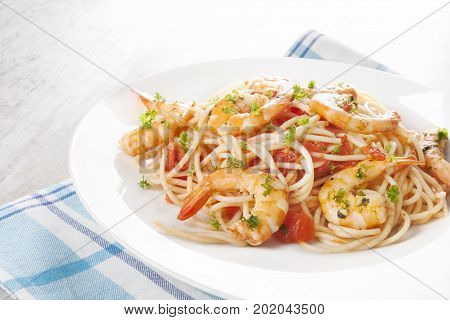 Fresh Spaghetti with shrimps on white plate. Delicious spaghetti