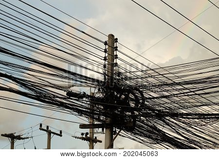 Power poles in Thailand, multiple power lines.