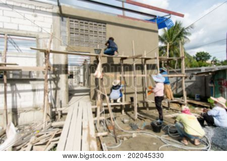 Blurry Background of Foreign workers are working in the construction site. Migrant workers are very popular in construction. Because apart from inexpensive labor is diligence.