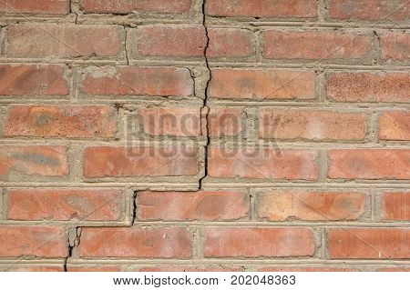High resolution texture of part of obsolete brick wall with a big crack