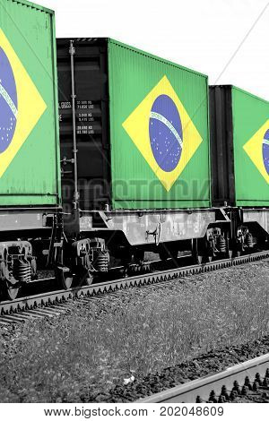 Train Freight transportation. Cargo transit. Summer Day. Container textured by flag of the Brazil