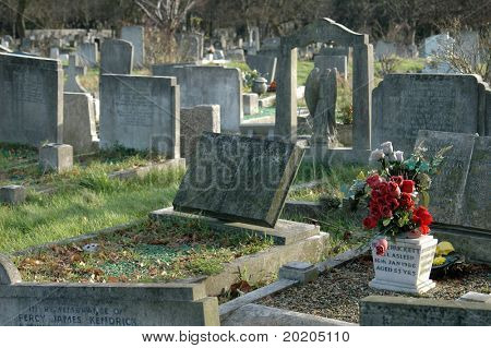 stone graves in a cemetery in london, england