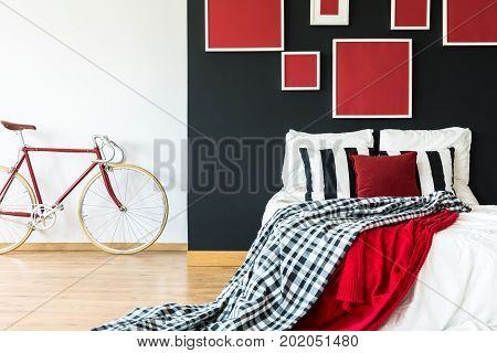 Minimalist Bedroom With Red Bike