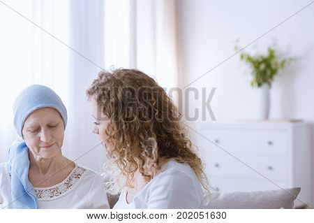 Woman Talking With Sick Mother