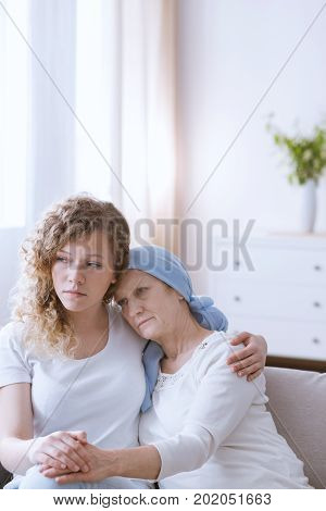 Woman With Headscarf Embraced By Daughter