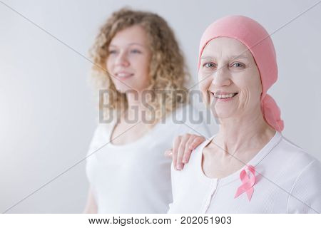 Caring Daughter Supporting Cancer Mother
