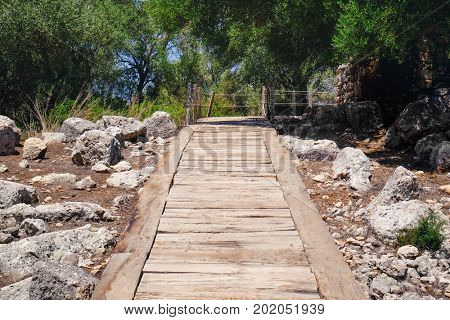 Beautiful view of wooden path on ground with stones