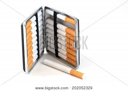 Cigarette case with tobacco filter cigarettes isolated with small shadows on a white background selected focus