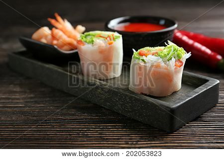 Fresh vegetable Vietnamese spring rolls with shrimps on table