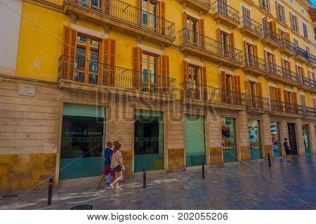 PALMA DE MALLORCA, SPAIN - AUGUST 18 2017: Unidentified people walking and the streets of Palma de Mallorca, Spain.