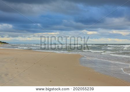 Wild sandy beach under cloudy sky of sunset in summer, Palanga Resort, Lithuania, Europe