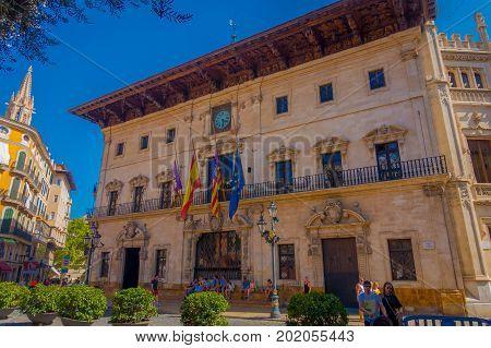 PALMA DE MALLORCA, SPAIN - AUGUST 18 2017: Unidentified people walking in the streets in a beautiful day with blue sky in Palma de Mallorca, Spain.